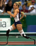 Shea Cowart of USA on her way to Gold in the Womens 100 m final in class 44 during the 2000 Paralympic Games. © Sean Garnsworthy/Allsport