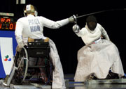 Jadwiga Polasik of Poland on her way to winning Gold in the women's class A Fencing final at the 2000 Paralympic Games. © Nick Wilson/Allsport