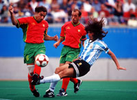 Mario Sosa of Argentina and Alvaro Duraes of Portugal fight for the ball at the Sydney 2000 Paralympics Games. © Adam Pretty/Allsport