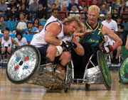 Stephen Pate of USA clashes with Brad Dubberley of Australia during the Mens Wheelchair Rugby Gold Medal Match during the 2000 Paralympic Games. USA won that match. © Scott Barbour/Allsport